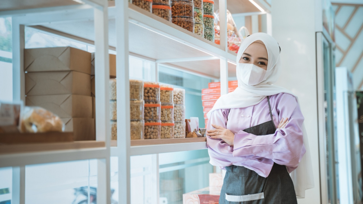 muslim-business-owner-with-mask-waiting-costumer-standing-window-her-shop-during-opening-new-normal